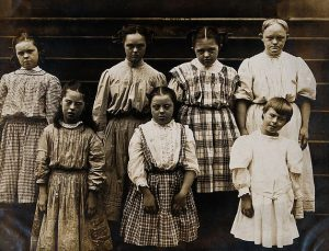 Vintage photo of girls with Down syndrome - nicely dressed.