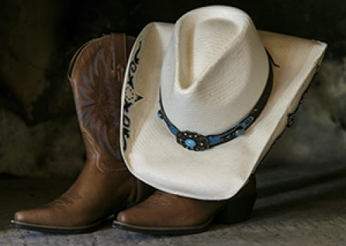 Cowboy boots and hat symbolizing the Western hoedown theme of the Advancing Opportunities fundraiser for people with disabilities in New Jersey
