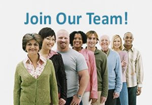 We're Hiring! Studio Shot of a Mixed Age, Multiethnic Group of Men and Women Standing in a Line