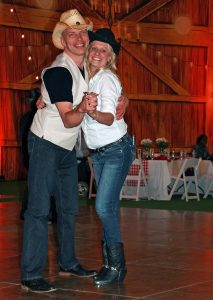 Couple engaged in Country Western dancing at the Advancing Opportunities Hoedown fundraiser help people with disabilities disability