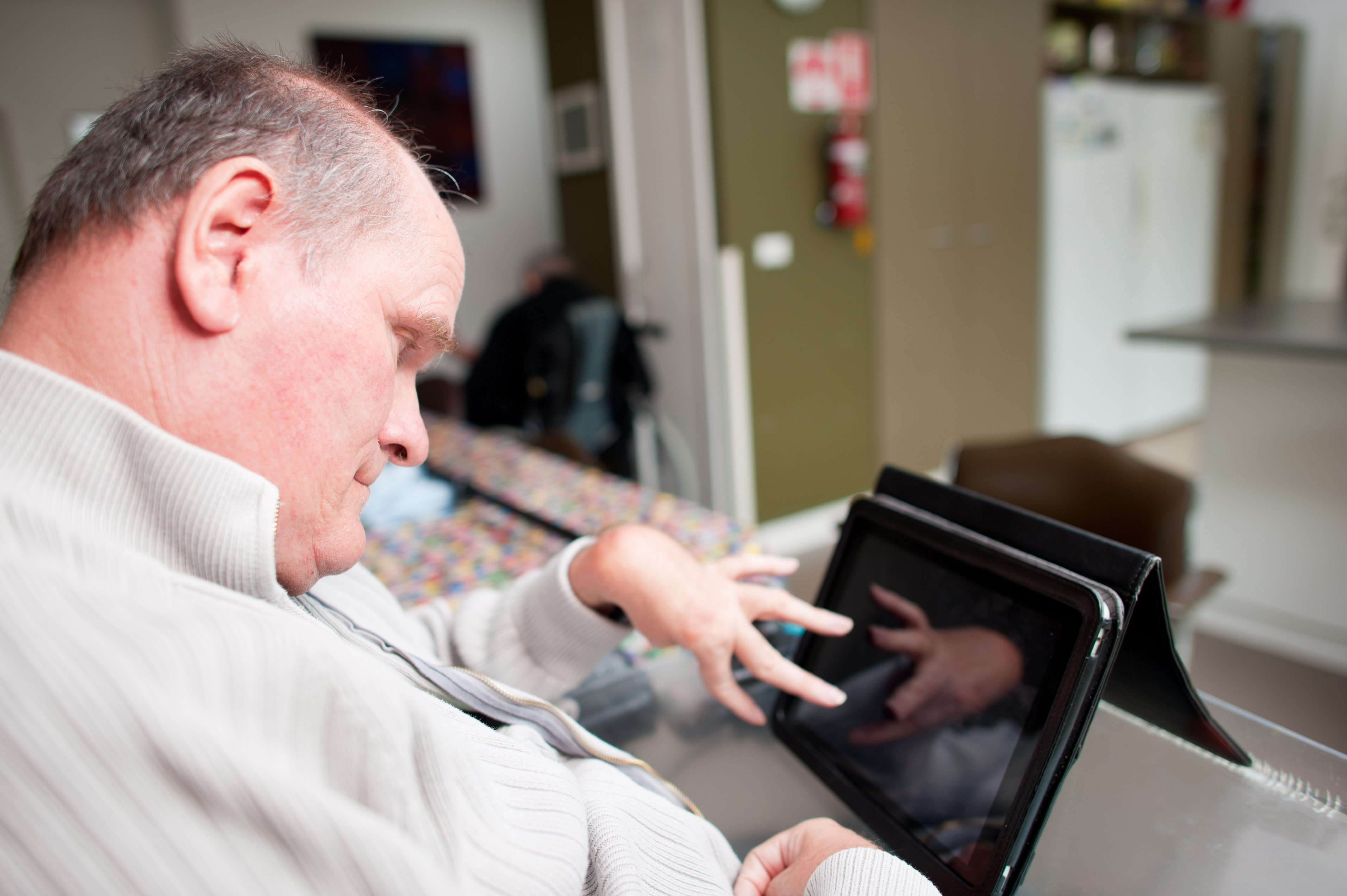 A man with cerebral palsy uses assistive technology for independence