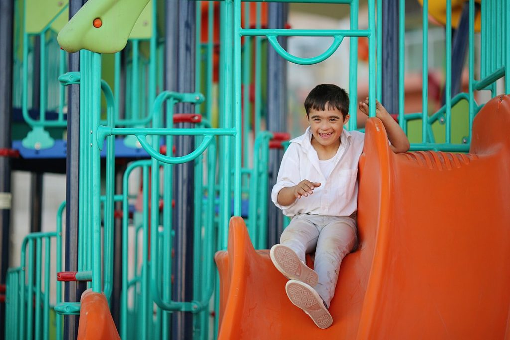 Boy with a disability in a park, inclusion