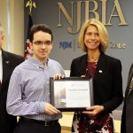 Advancing Opportunities' CEO Jack Mudge, student Raul Rodriguez and Career Development Specialist presenting NJBIA President and CEO Michele Siekerka with the Champion of Inclusion Award.