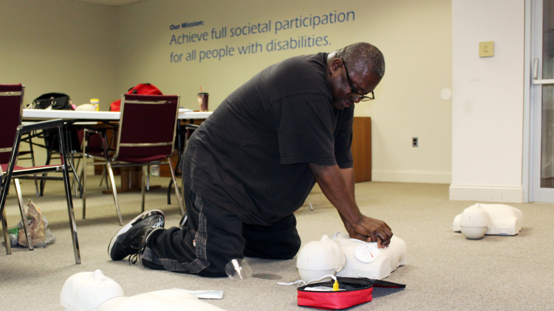 Man performing CPR on a dummy